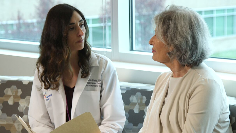 Nurse navigator speaking with cancer patient