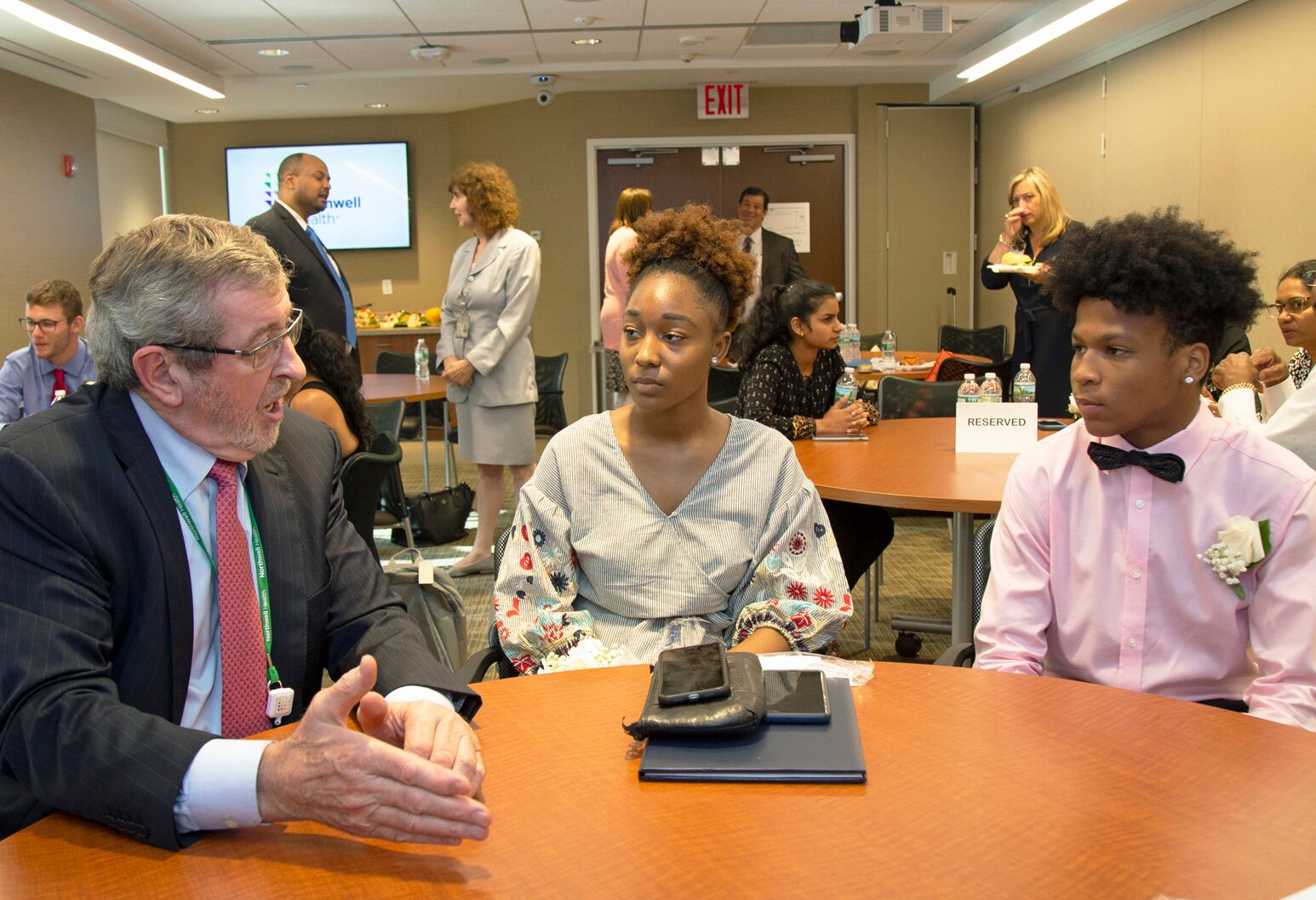 From left: Michael J. Dowling, president and CEO of Northwell Health, speaking with STEM scholarship recipients Micaela Harmon and Solomon Richards.