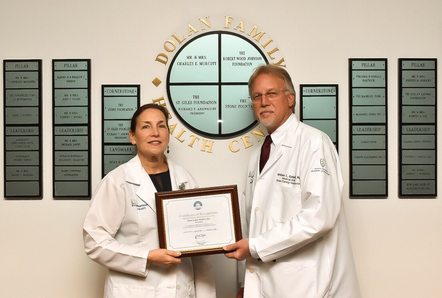Kathy Giffuni, RN, assistant director, nursing-ambulatory and William Gehrhardt, MD, medical director, from the Dolan Family Health Center, honored to receive NCQA recognition.