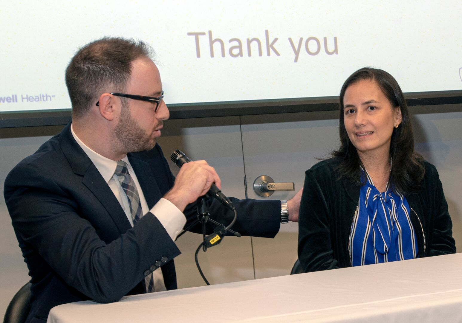 Gary Deutsch, MD, and Emma Barros discuss the robotic Whipple procedure during her 40th birthday party at Long Island Jewish Medical Center.