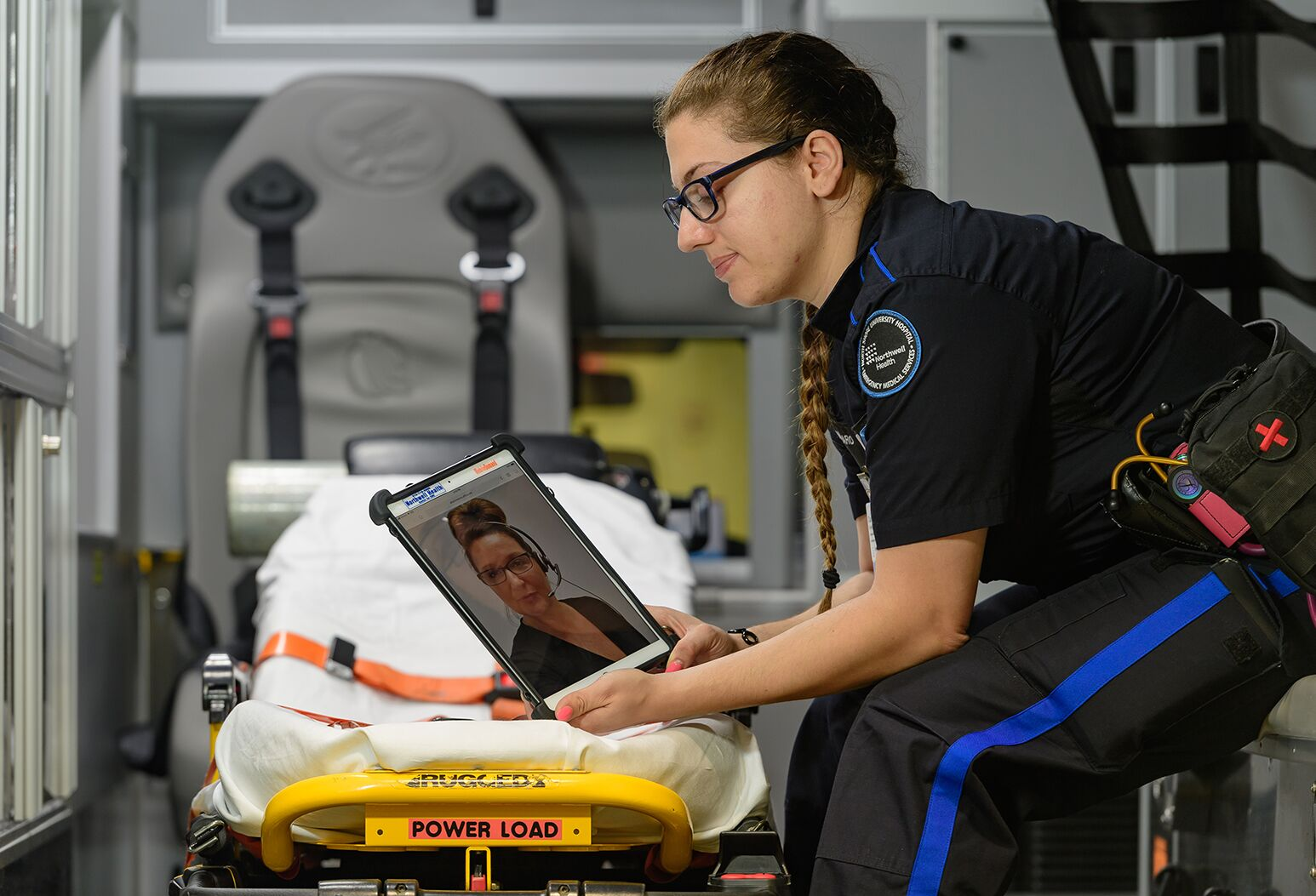 Northwell Health Paramedic Danielle Conigliaro calls up a LanguageLine translator via an app on an iPad.