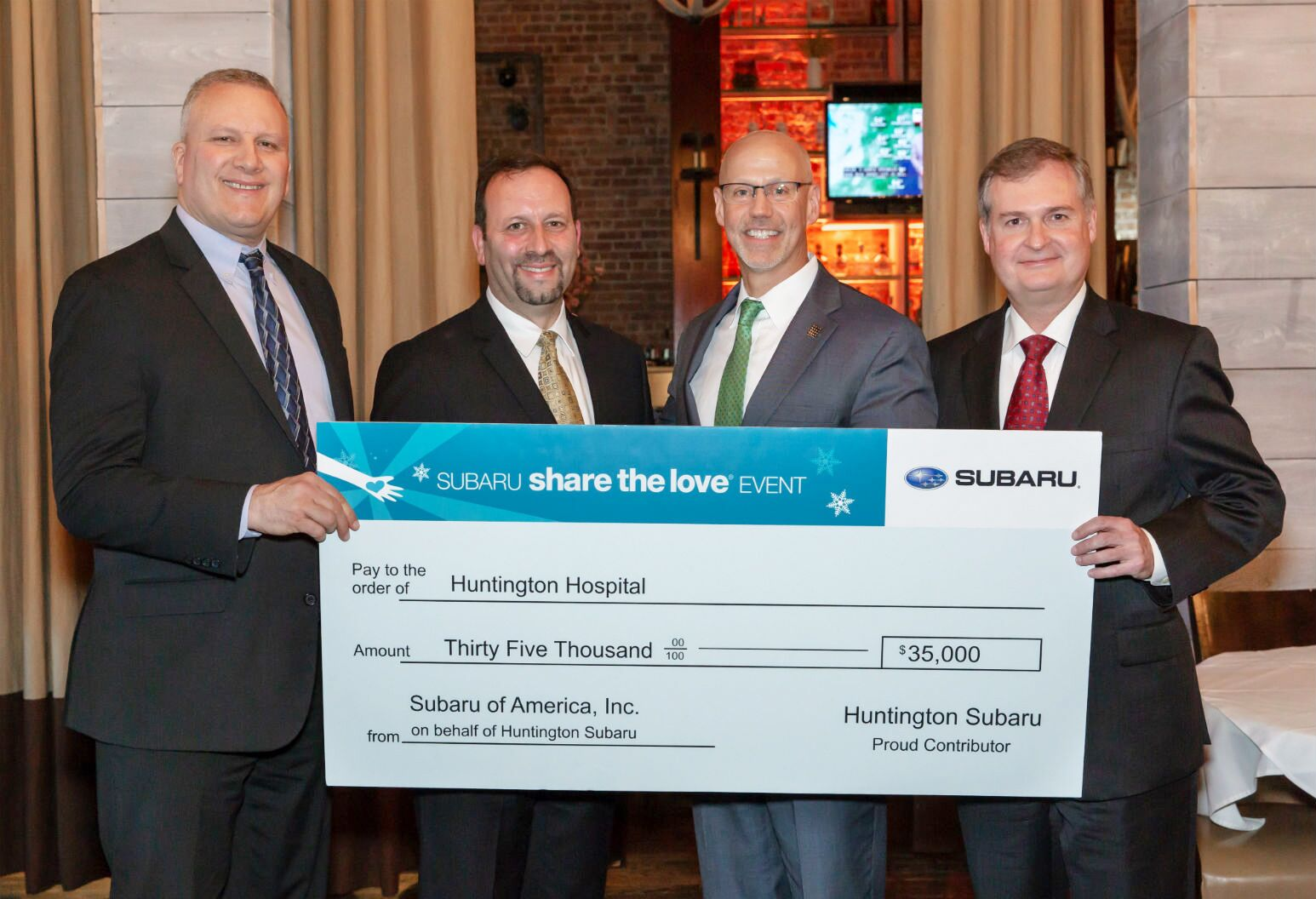 Huntington Subaru representatives present Huntington Hospital's Dr. Nick Fitterman and Dr. Robert Kerr with a $35,000 donation.