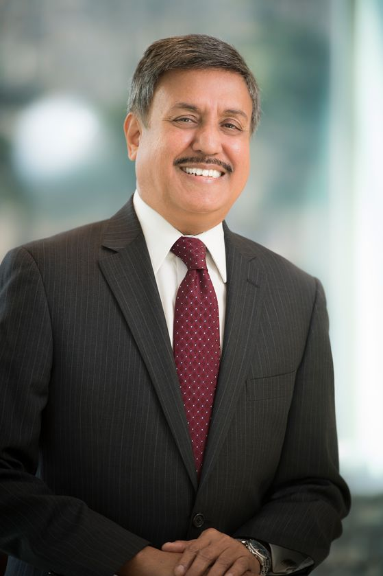 Ram Raju, MD, wearing a red tie