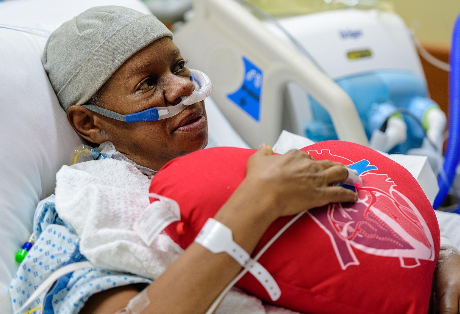 The Well heart transplant Yvonne Fleming holding heart pillow