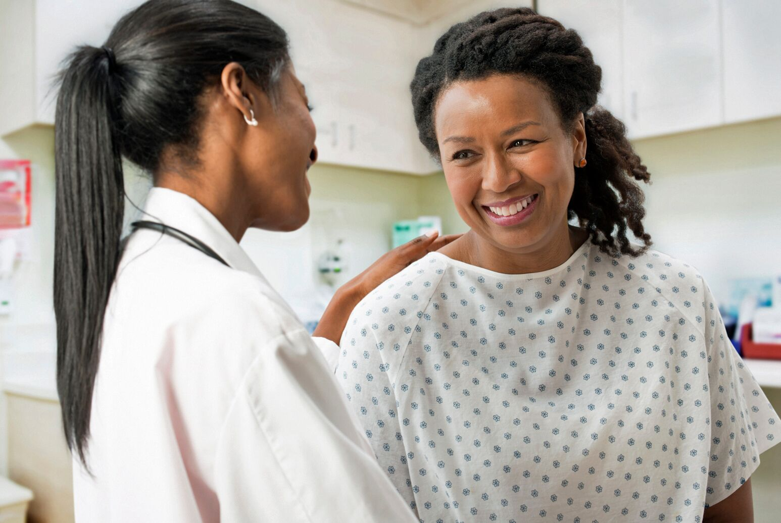 A female clinician holds a black woman's shoulder. Benjamin Schwartz, MD, talks about how doctors can connect better with patients to improve experiences