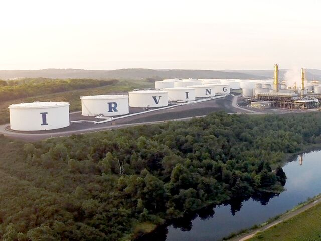 """alt=""""aerial view of wetland reserve and refinery"""""""