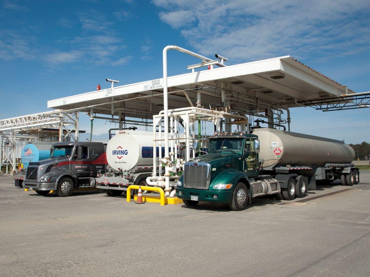 """alt=""""fuel transport trucks being filled"""""""