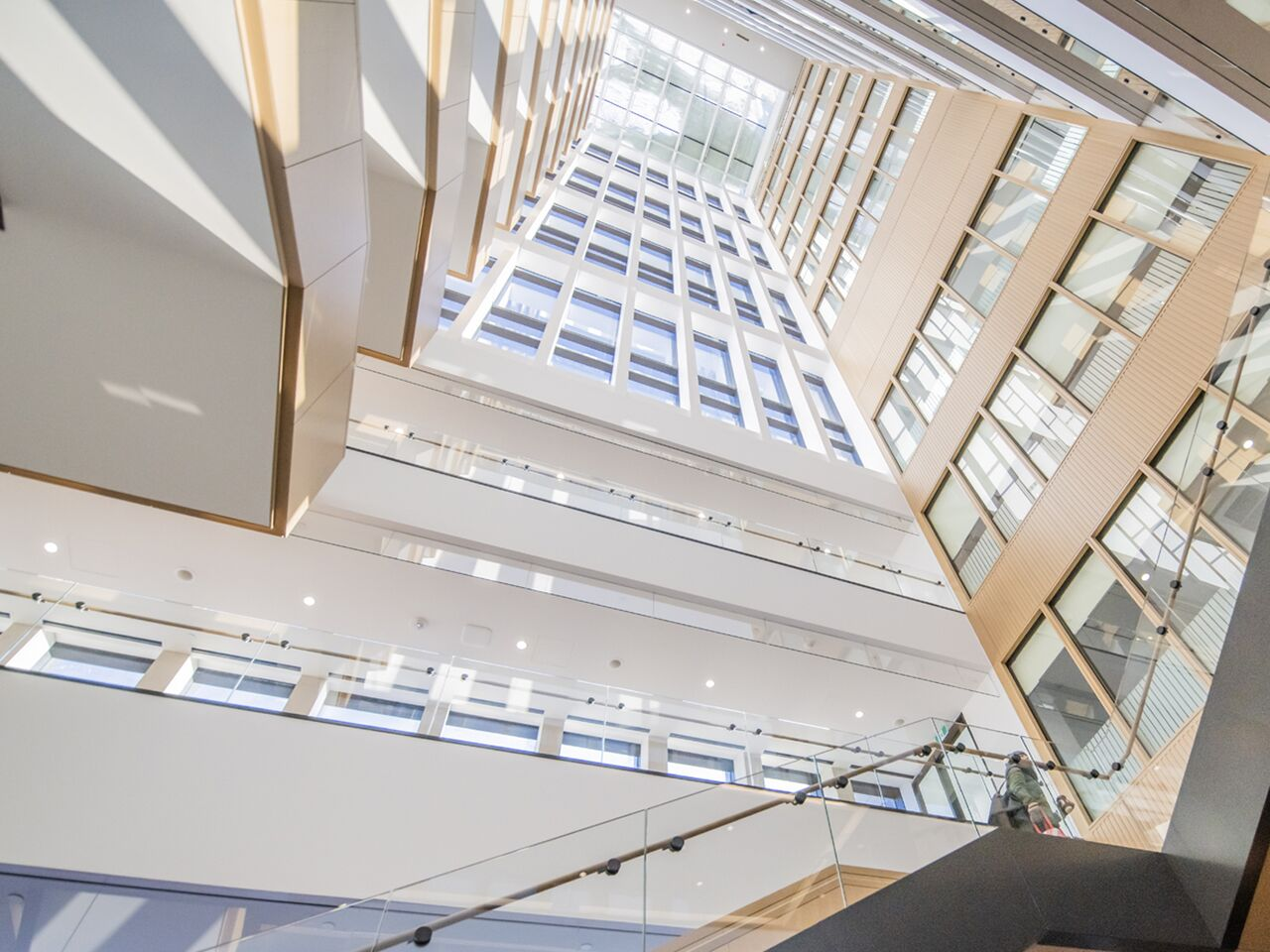 "alt=""bright atrium staircase and skylights"""