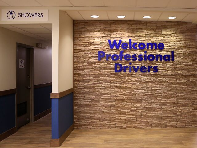 "alt=""welcome professional drivers sign on wall"""