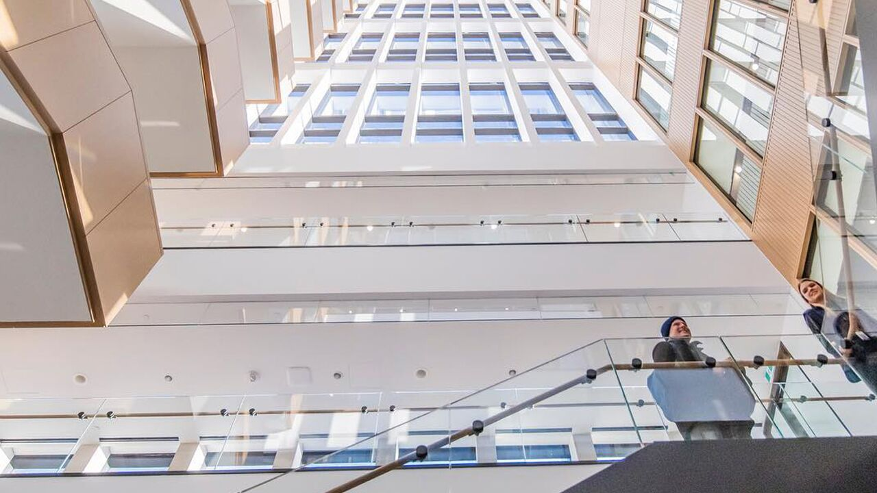 "alt=""employees climbing office building stairs"""