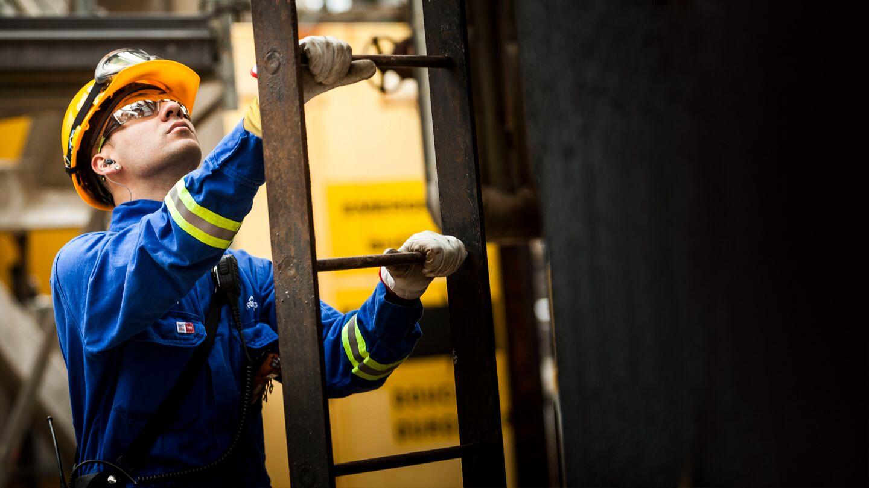 """alt=""""refinery worker climbing ladder"""""""