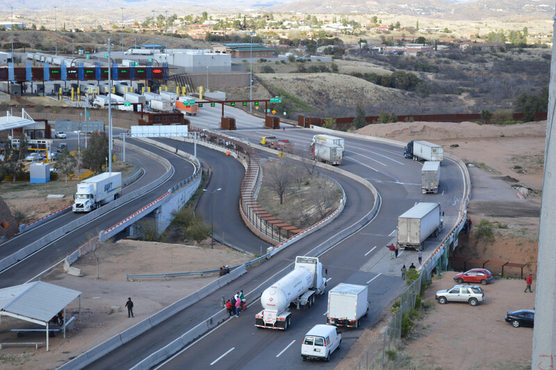 Trucks from Mexico approach border crossing 1